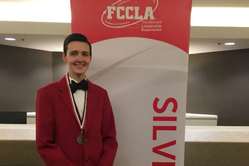 Student in front of FCCLA banner